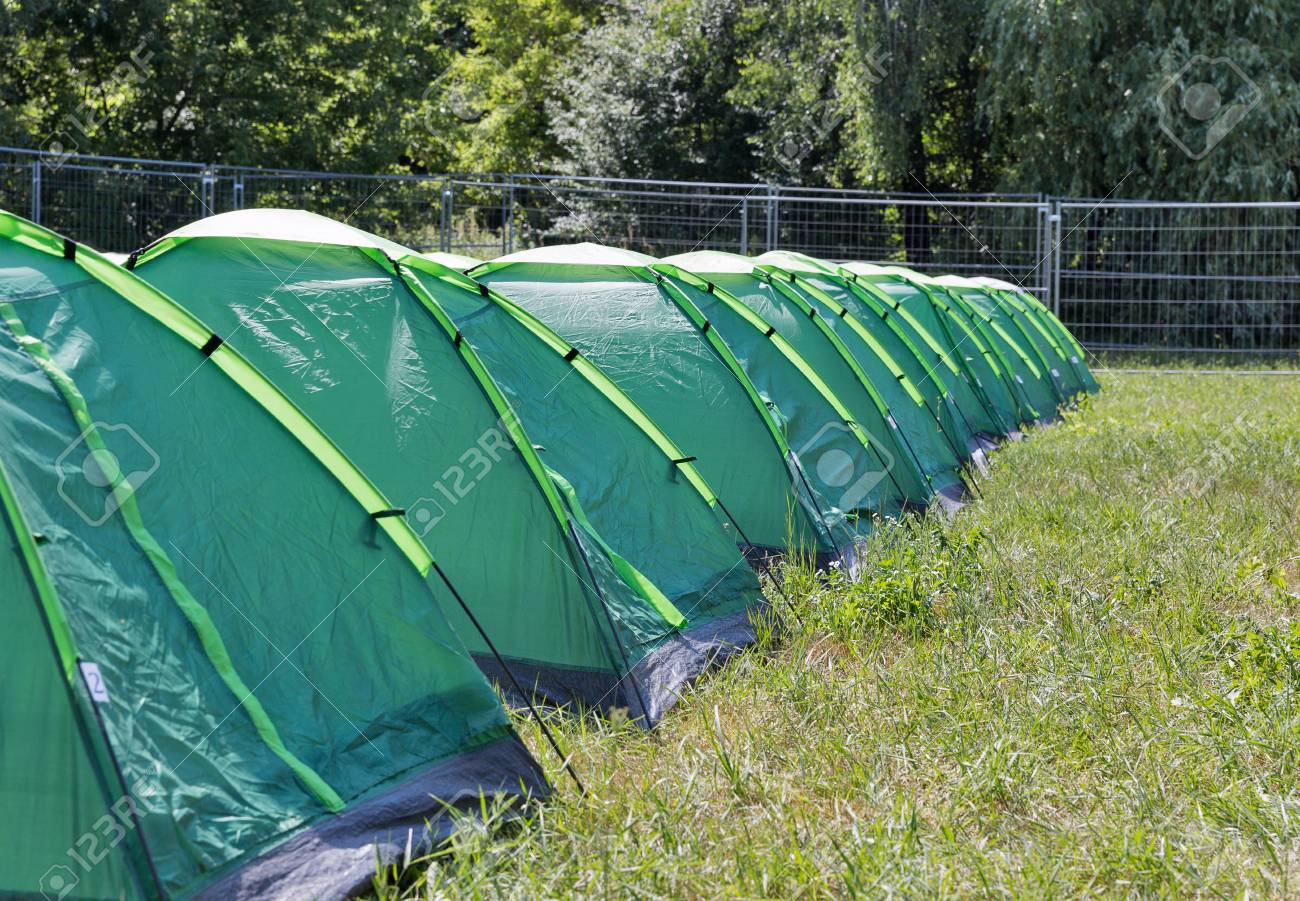 Row of new green c&ing tents on c&ground. Stock Photo - 82936167 & Row Of New Green Camping Tents On Campground. Stock Photo Picture ...