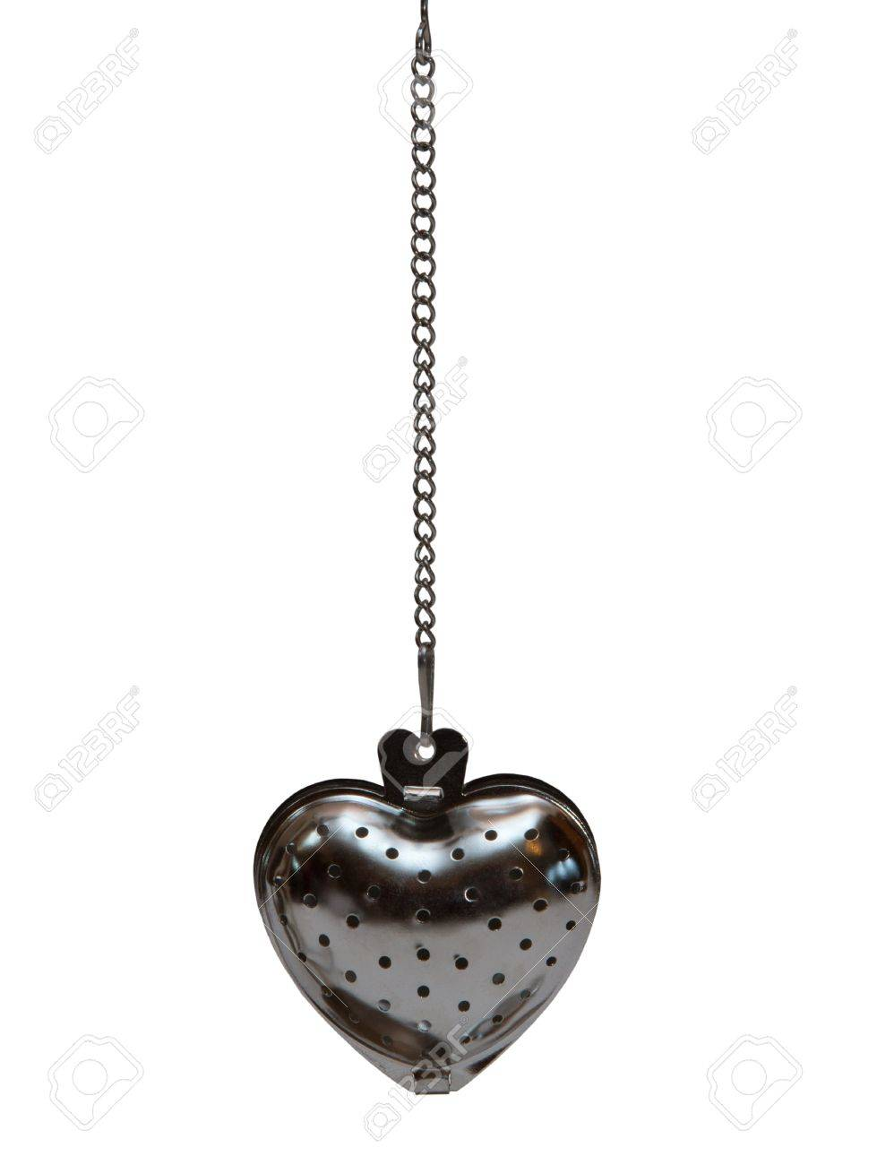 tea strainer in the shape of a heart on a chain Stock Photo - 17793441