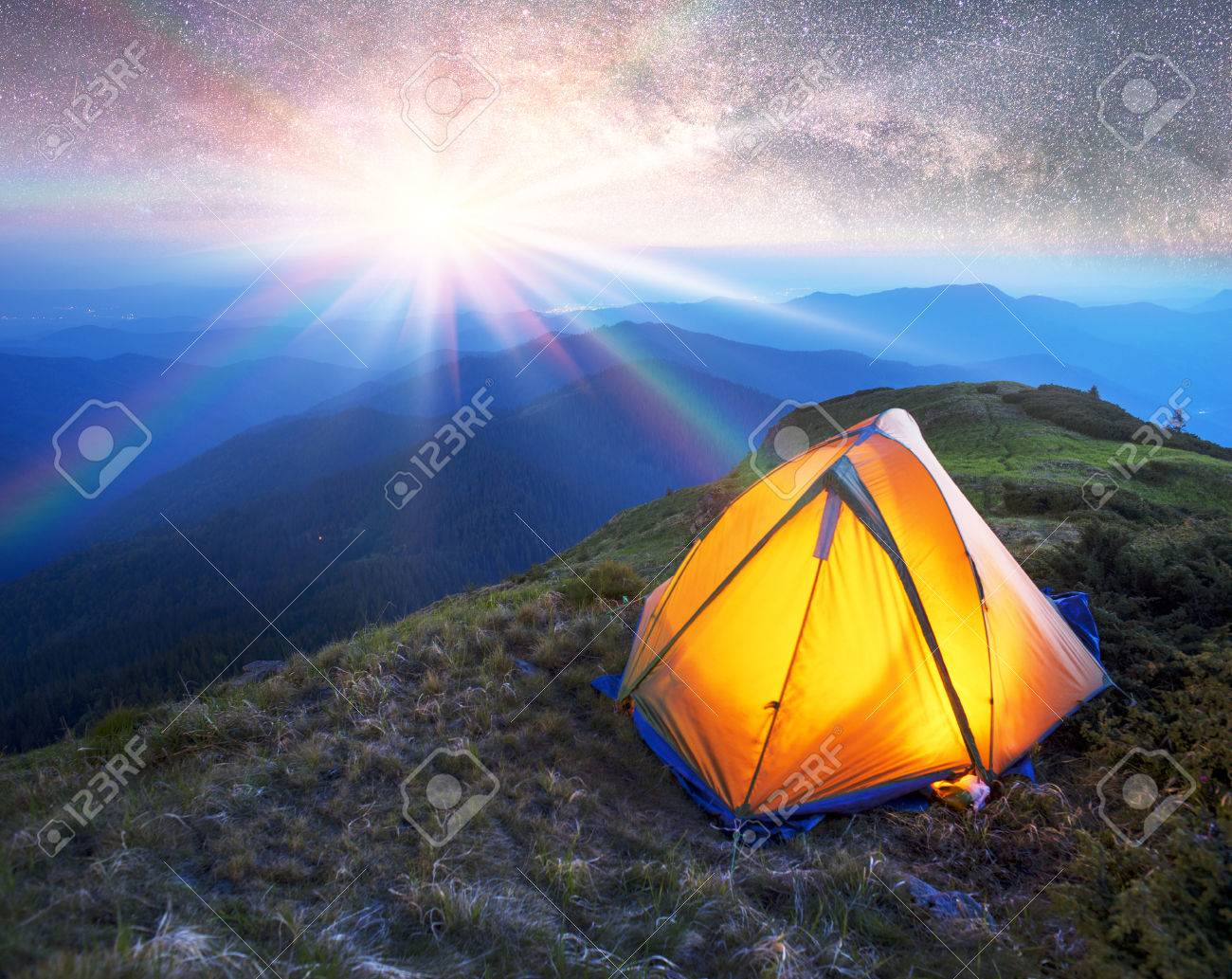 Tent mountaineering climbers among fantastically beautiful scenery on the background of an alpine wilderness of the & Tent Mountaineering Climbers Among Fantastically Beautiful Scenery ...