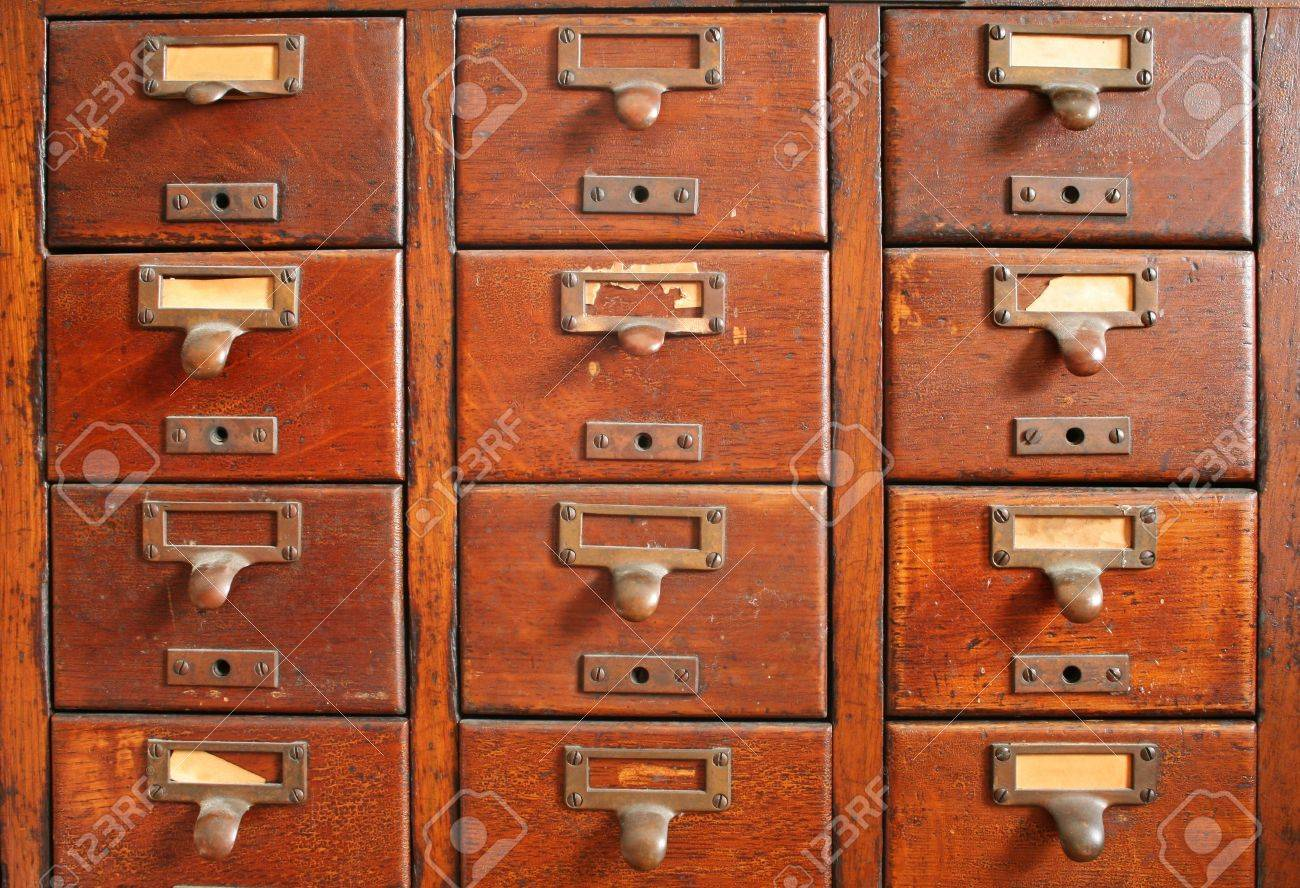 old wooden card catalog with brass pulls and some old yellowed blank paper labels Stock Photo - 3264512