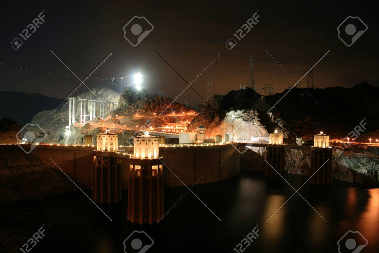 Hoover Dam at night from the upstream side with bridge construction underway Stock Photo - 3659475
