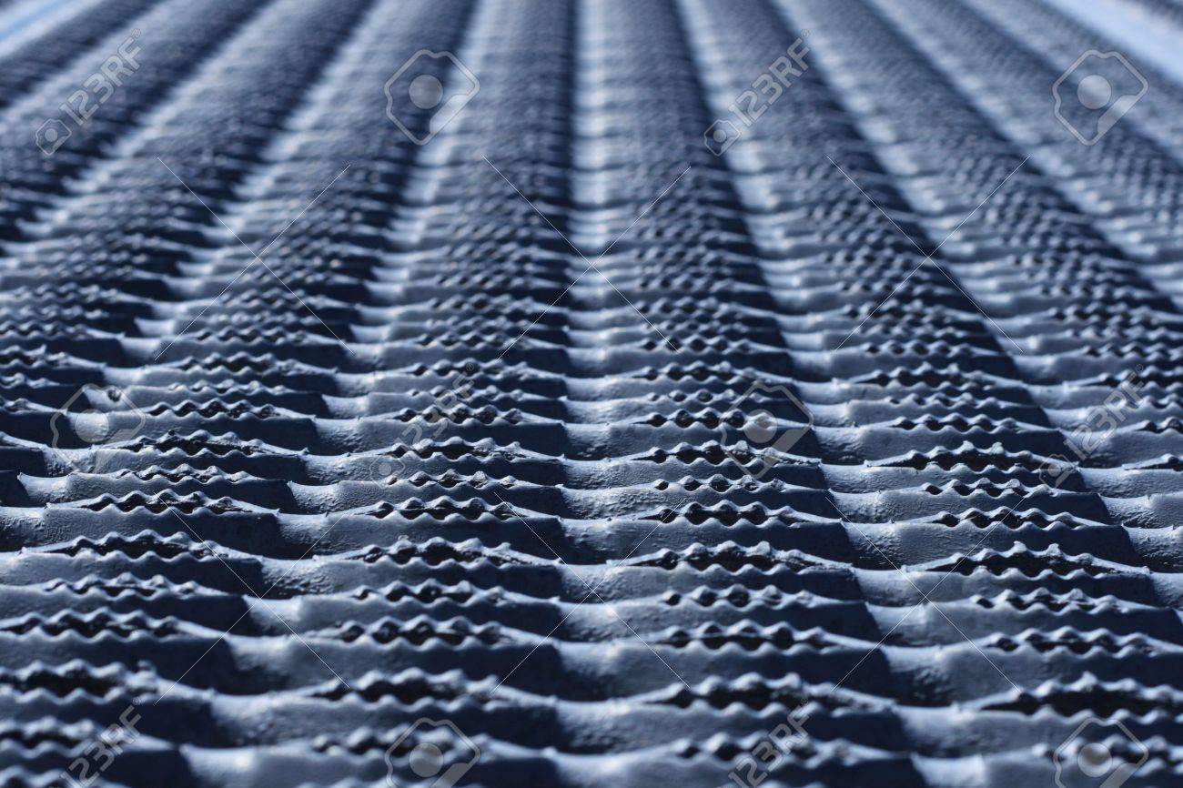 horizontal image of non skid textured corrugated metal tread painted gray Stock Photo - 3747710