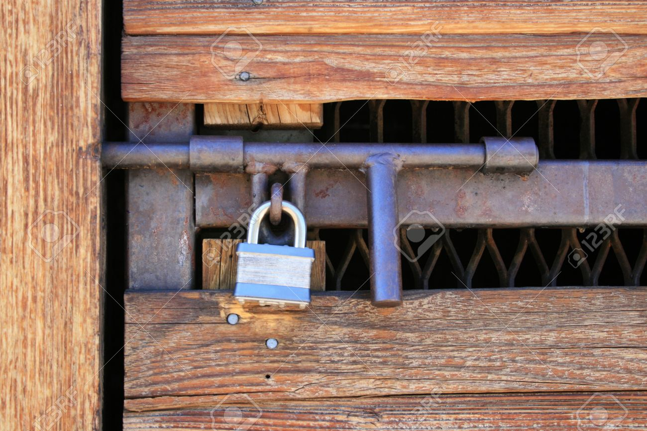 padlocked wood and metal door with heavy duty hasp Stock Photo - 3977180 & Padlocked Wood And Metal Door With Heavy Duty Hasp Stock Photo ...