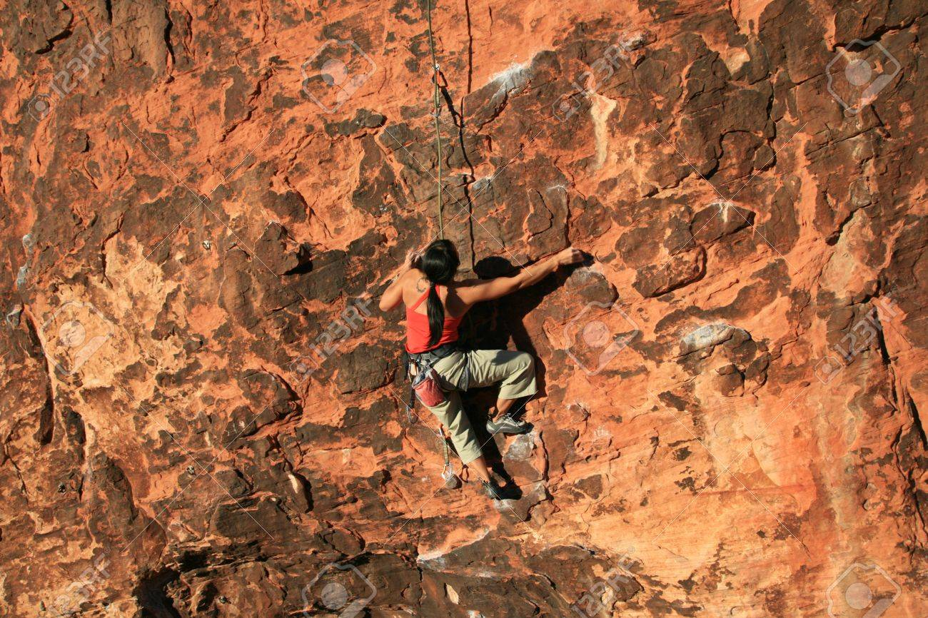 woman rock climber in red climbing a red sandstone cliff at Red Rocks, Nevada Stock Photo - 4270730