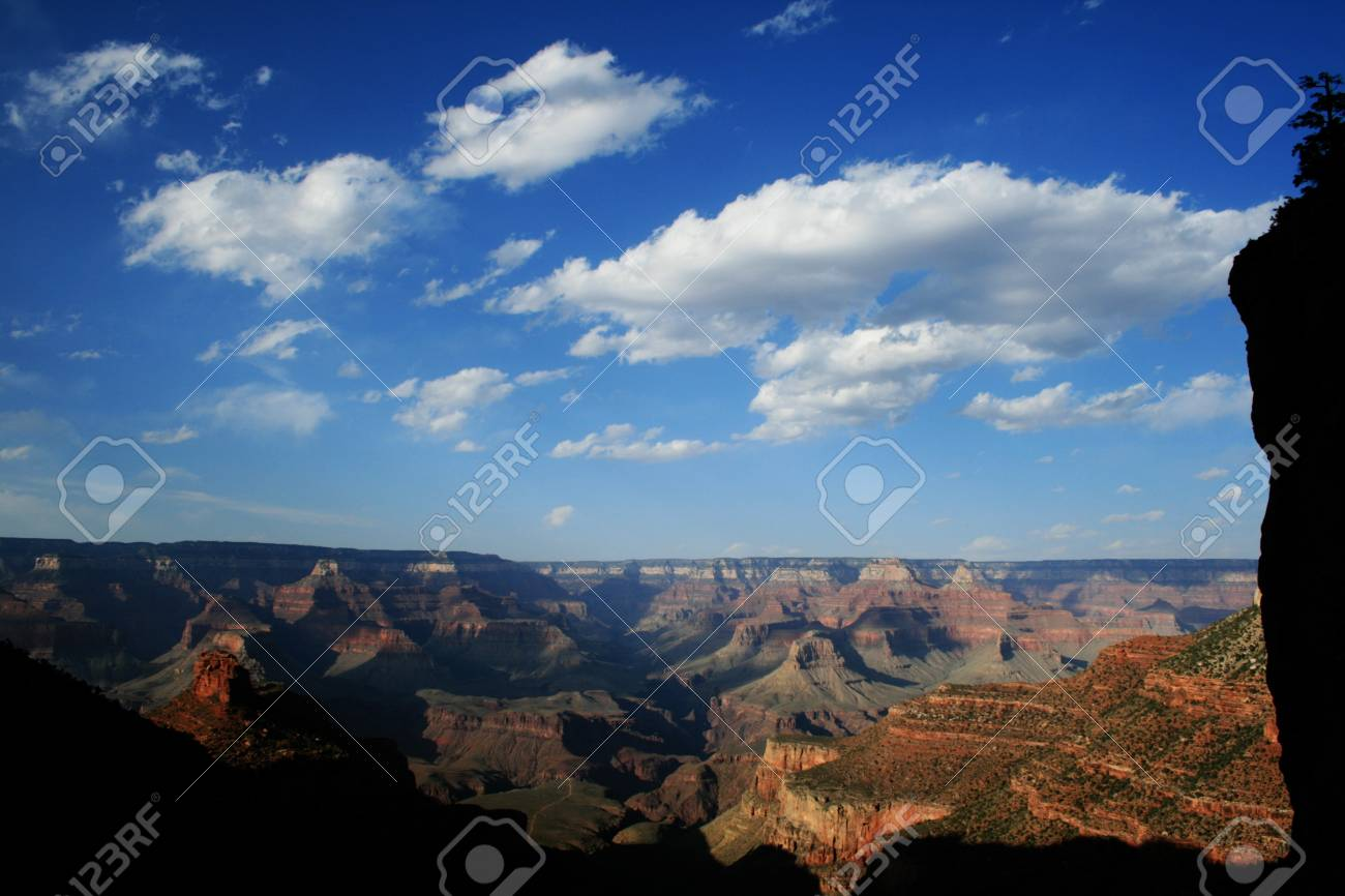 the Grand Canyon in the late afternoon from the Bright Angel Trail framed by shadows and silhouetted cliffs Stock Photo - 4307527