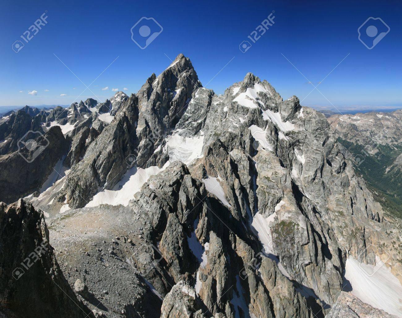 Grand Teton and Mount Owen from the summit of Teewinot peak Stock Photo - 6136051