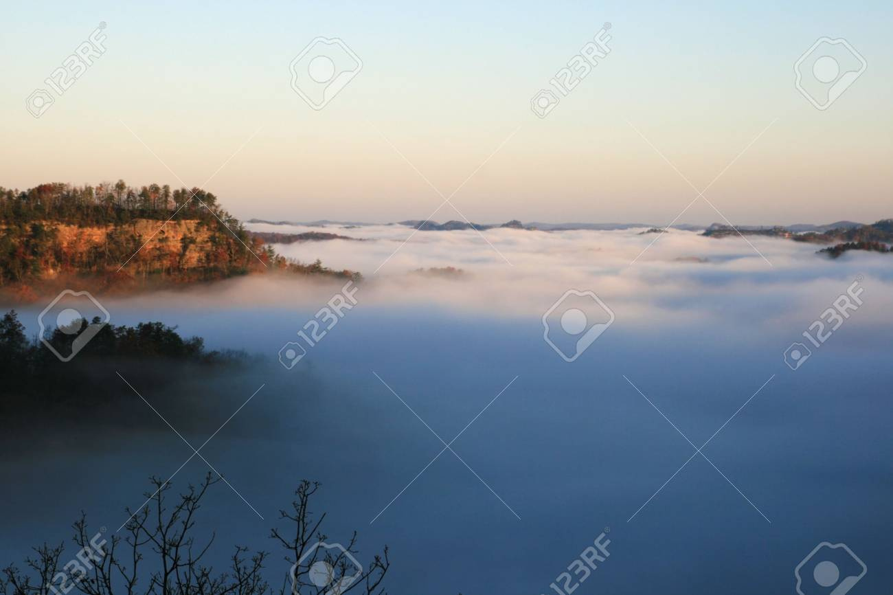a fog filled valley in the autumn just after sunrise with distant ridges visible Stock Photo - 6605833