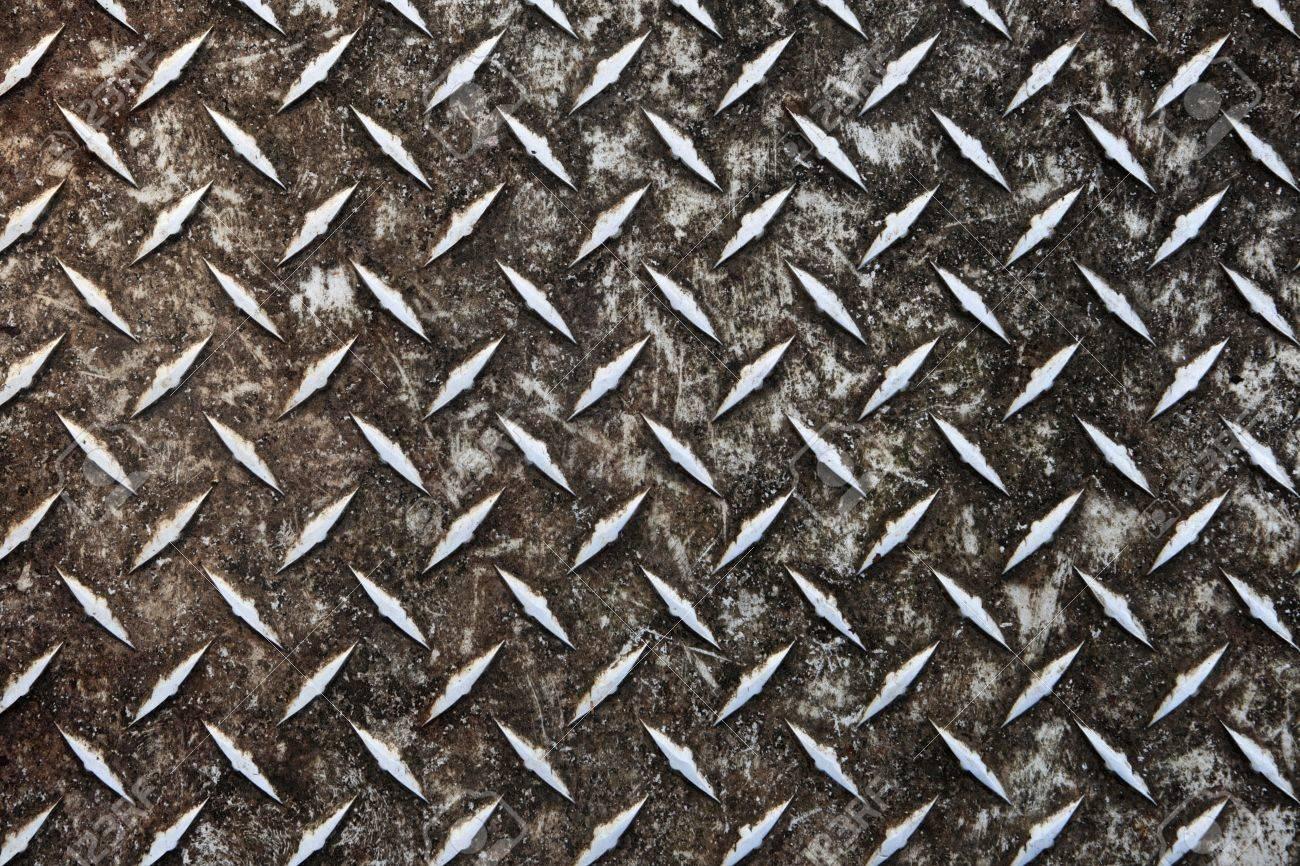 dirty worn aluminum diamond plate non-skid surface Stock Photo - 8457699