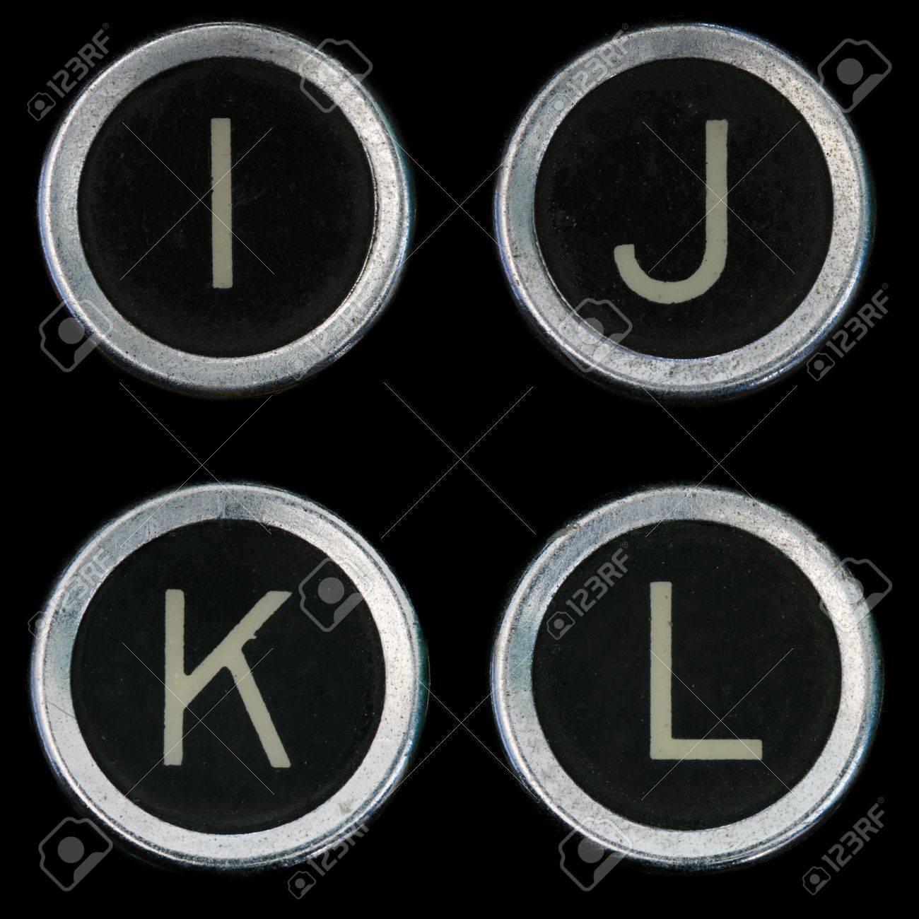 I J K L keys from old typewriter on black background Stock Photo - 8564312