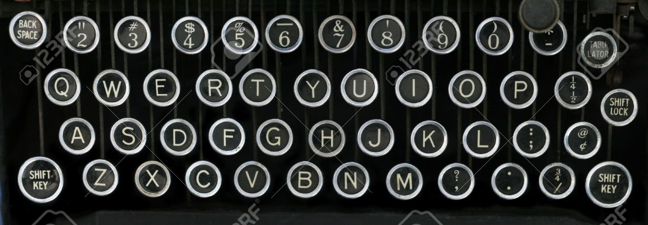 old typewriter keyboard with silver and black round keys with a black background Stock Photo - 8613919