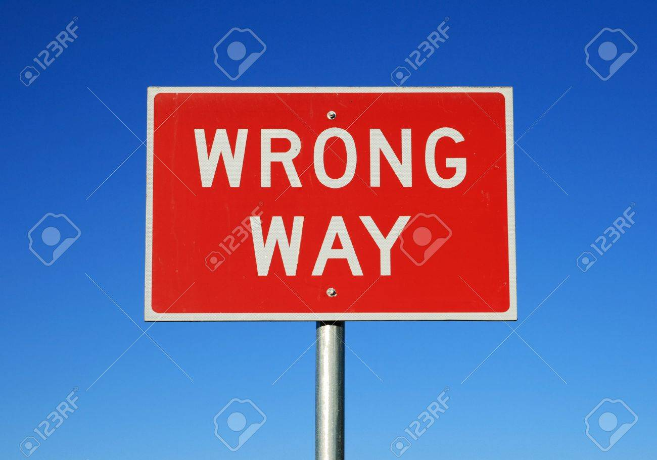 wrong way road sign on a blue sky background Stock Photo - 9948376