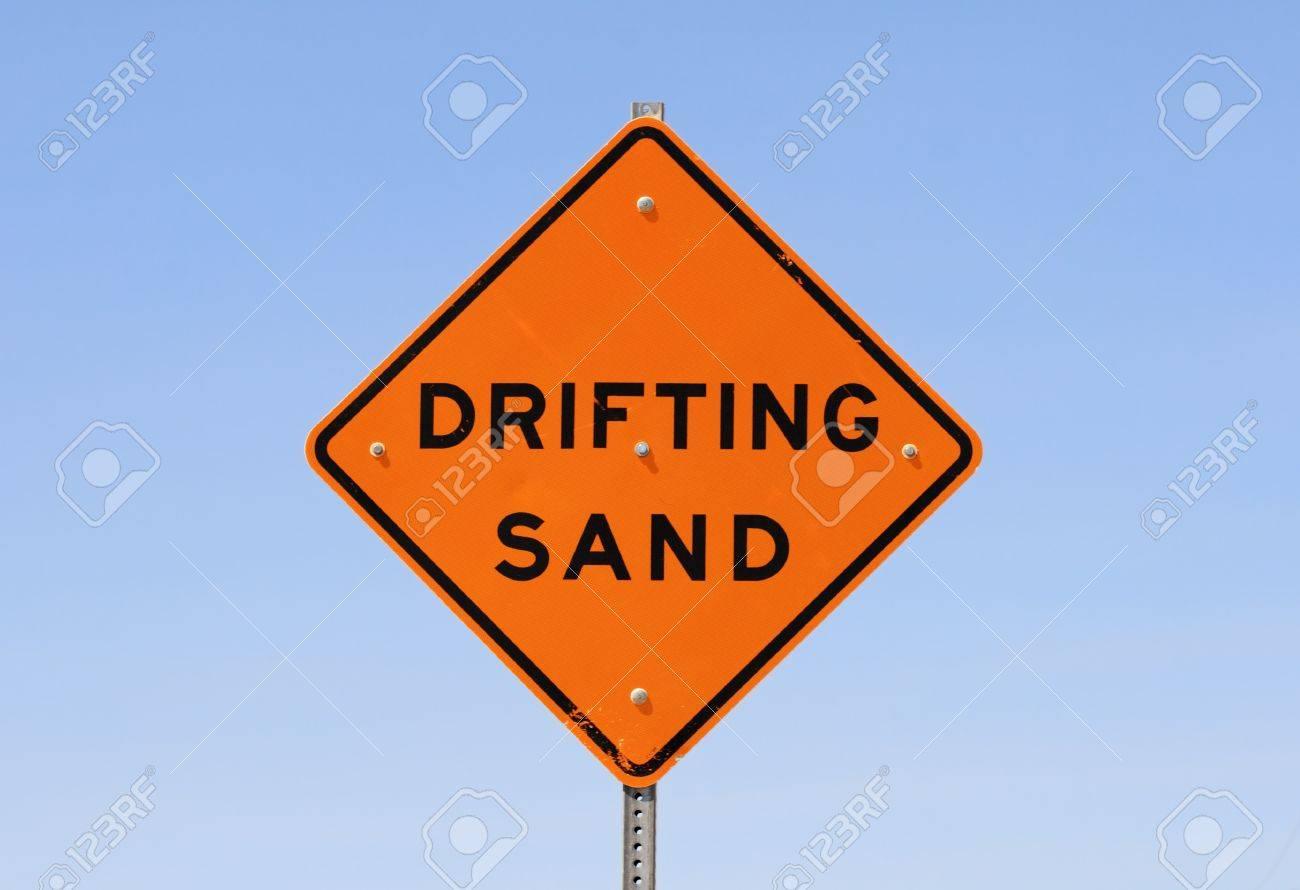 orange and black drifting sand road sign with blue sky background Stock Photo - 10496248