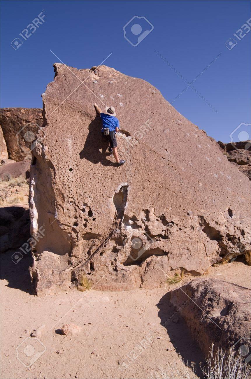 a man rock climbing a tall boulder Stock Photo - 12379993