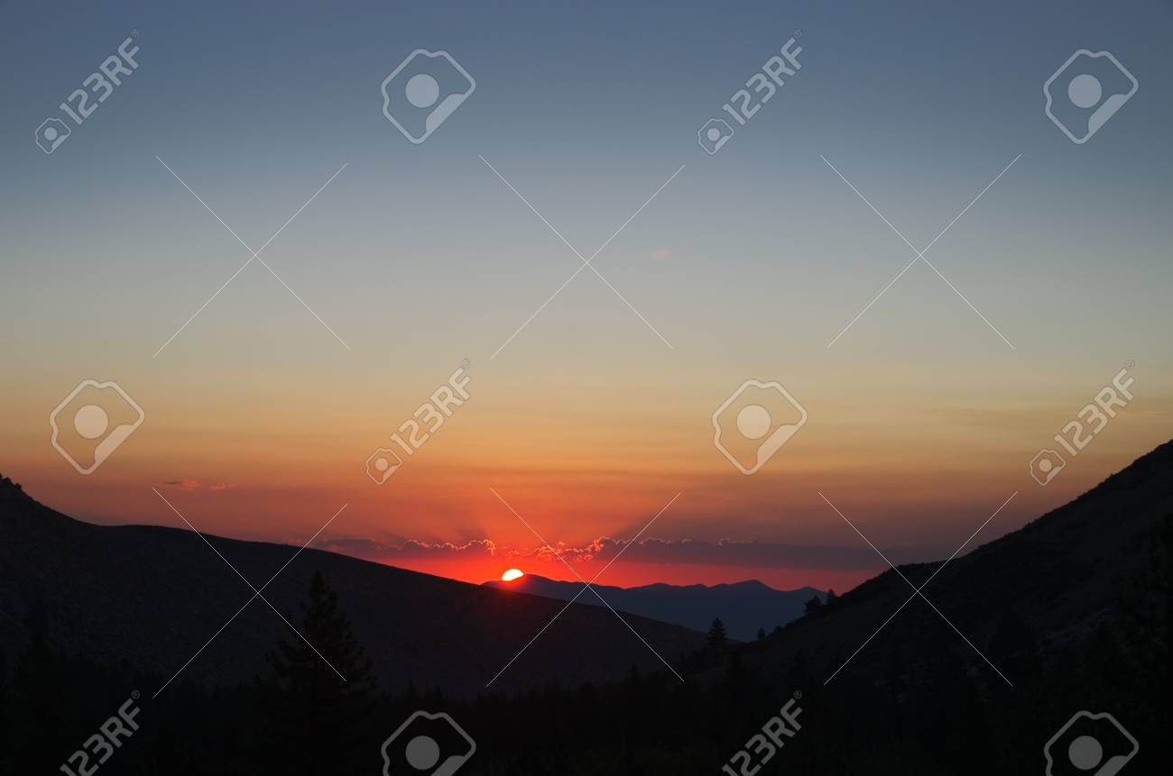 mountain sunrise with brightly edged clouds and copy space Stock Photo - 15039521