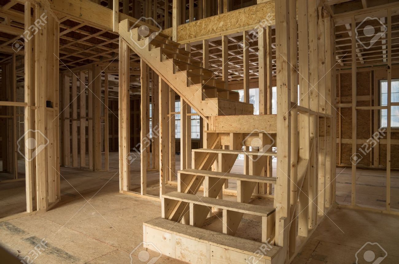 New House Construction Interior With Exposed Framing And Stairs Stock Photo    19586599