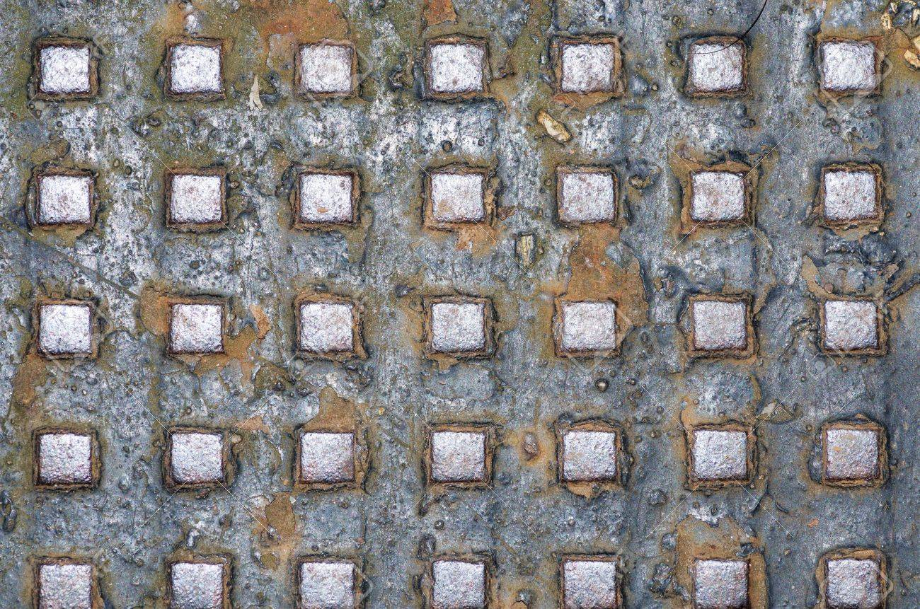 old metal background texture with cracked paint rust and raised square texture bumps Stock Photo - 20427032