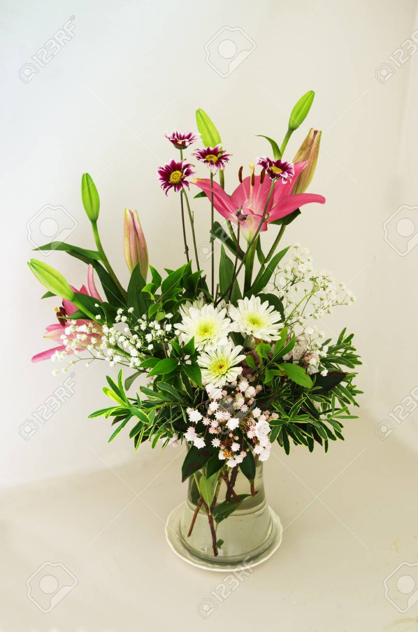 spring flower bouquet arrangement with lily daisy and laurel flowers Stock Photo - 20436461