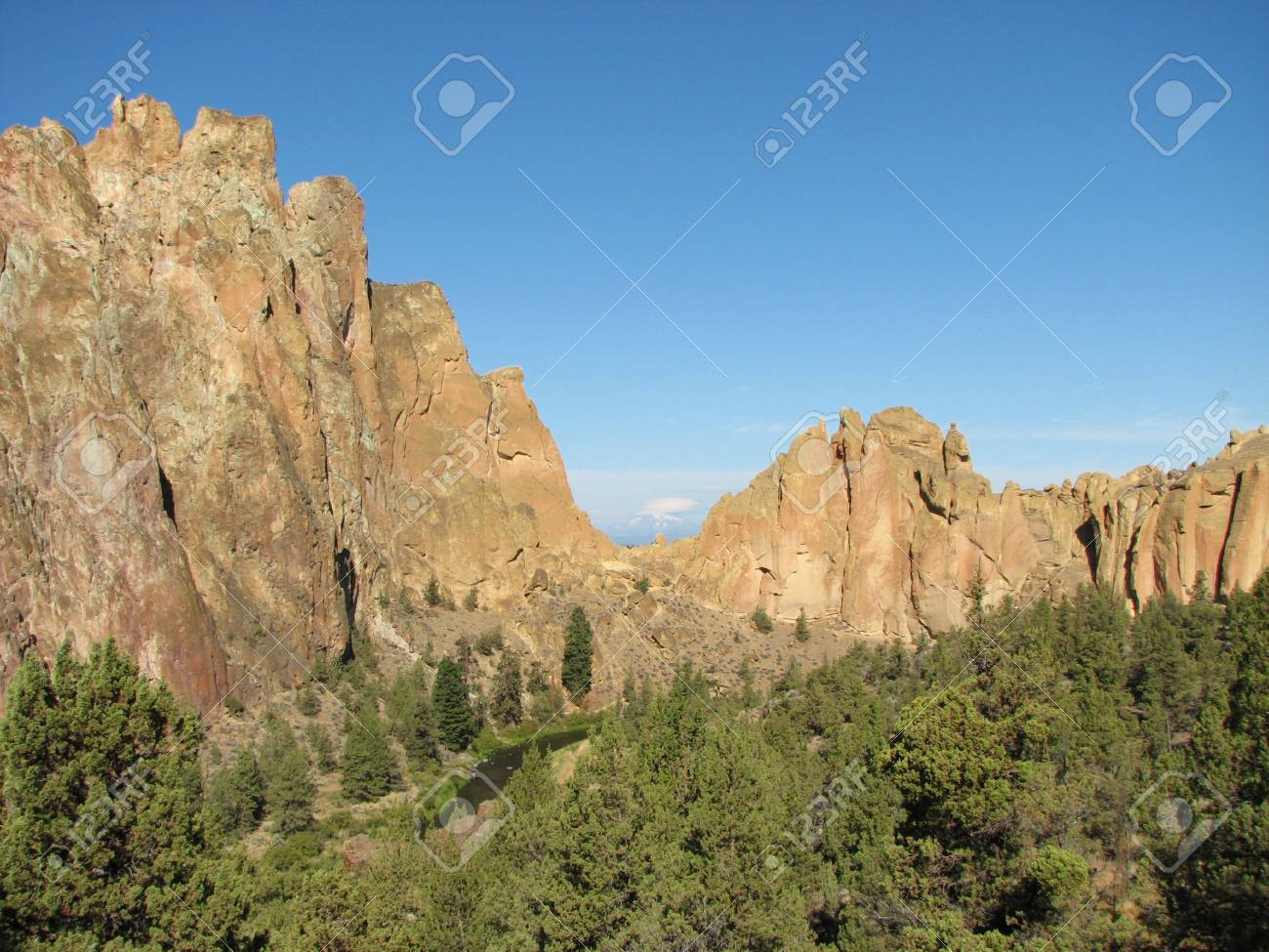 view of cliffs at Smith Rock State Park, Oregon with Mount Jefferson visible through asterisk pass Stock Photo - 23193247