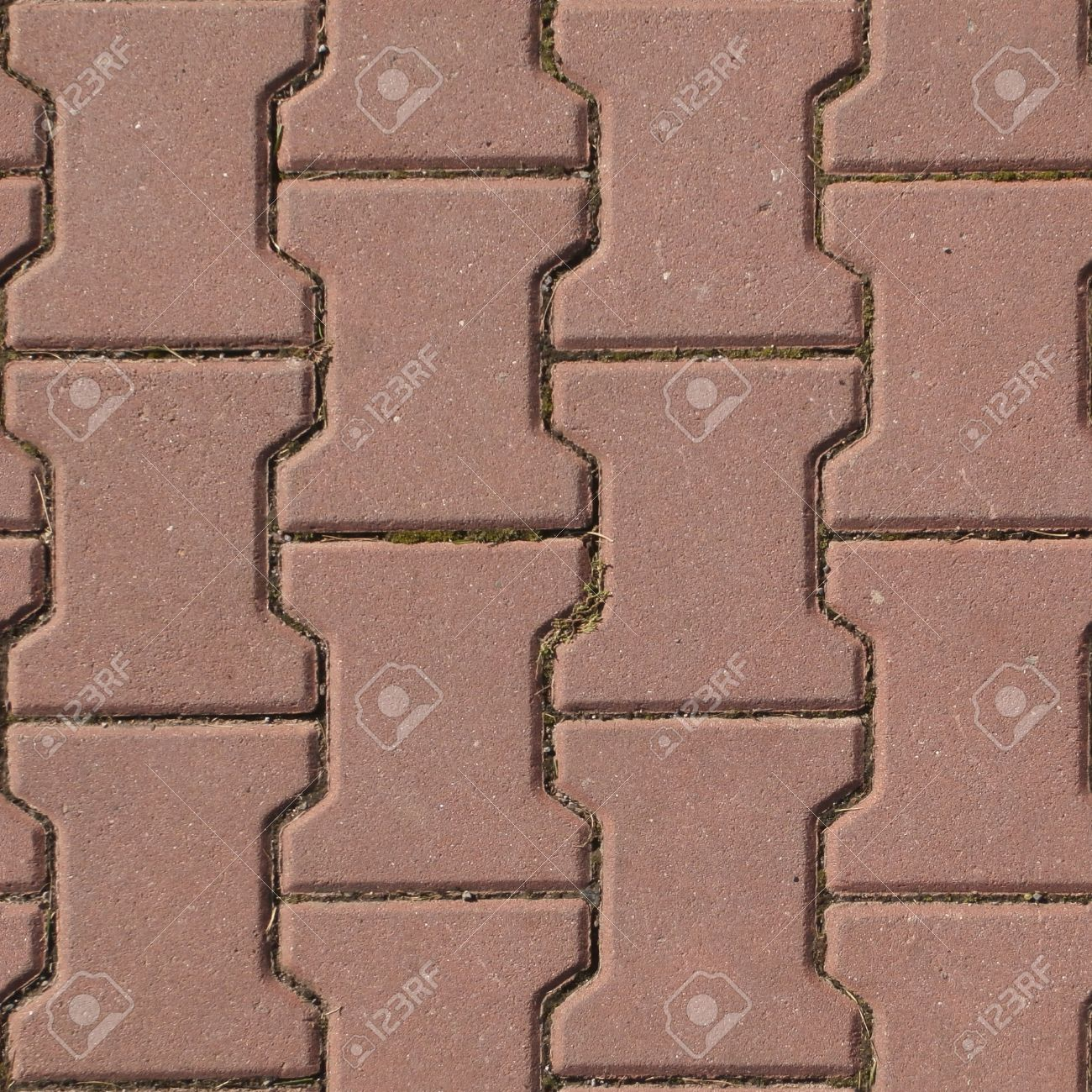 . Seamless red cobblestone pavement texture or background
