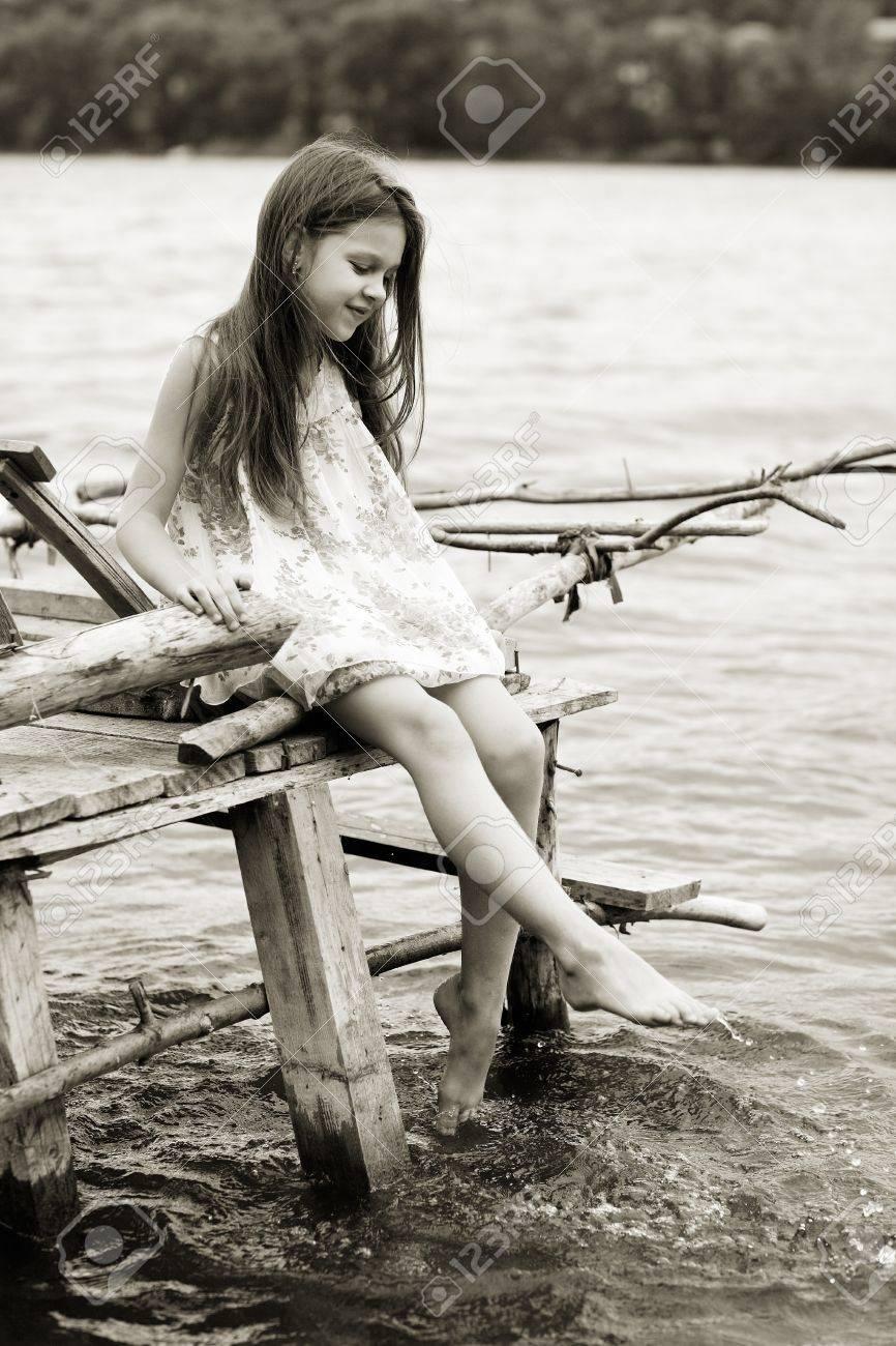 Little girl a park near the river Stock Photo - 10360331