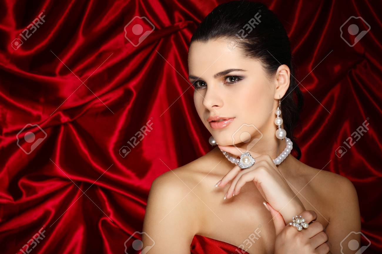 A beautiful young woman is in red clothes Stock Photo - 10501403