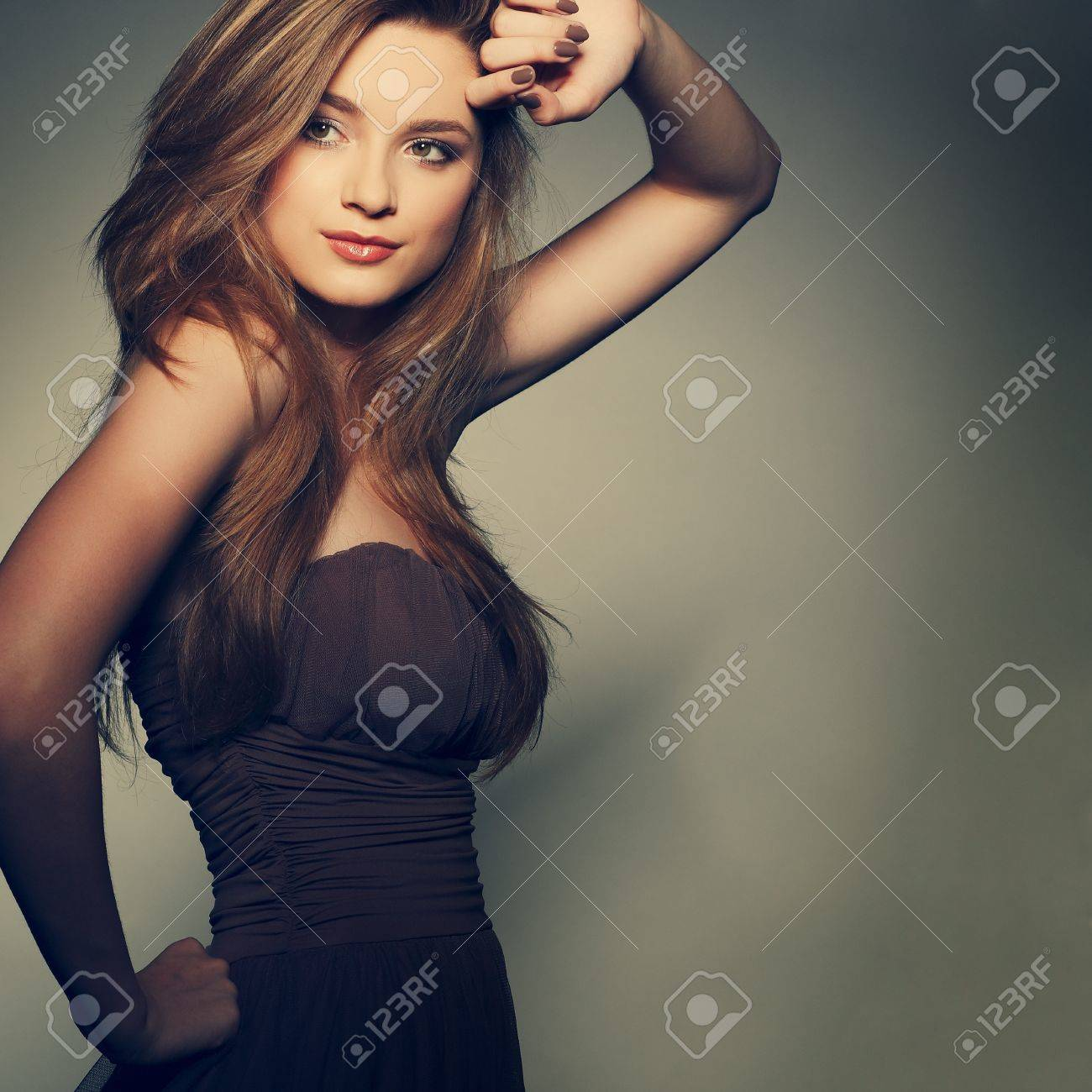 A beautiful young woman is in brown clothes Stock Photo - 11423887