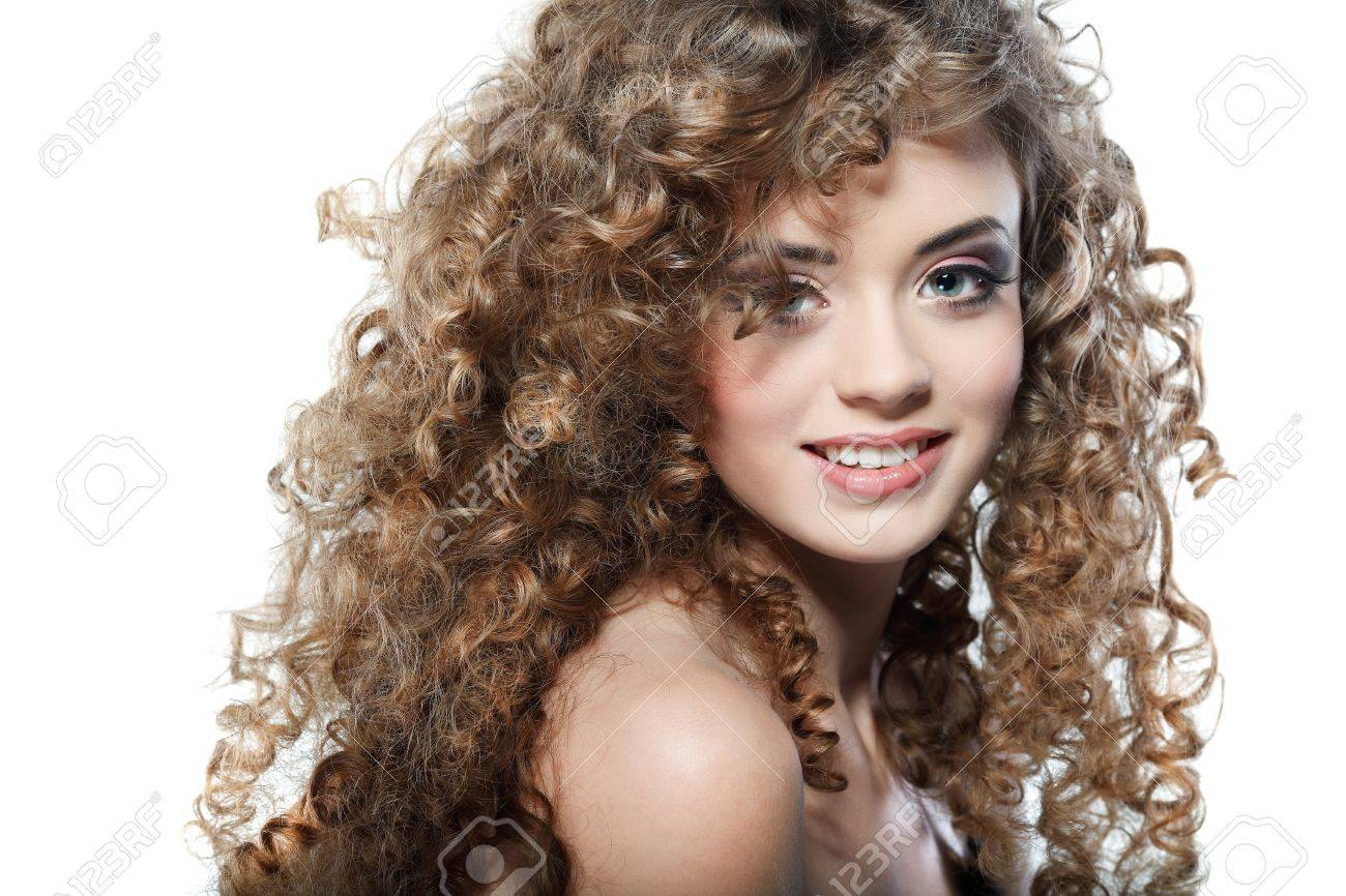 Young beautiful woman with long curly hairs Stock Photo - 17501596