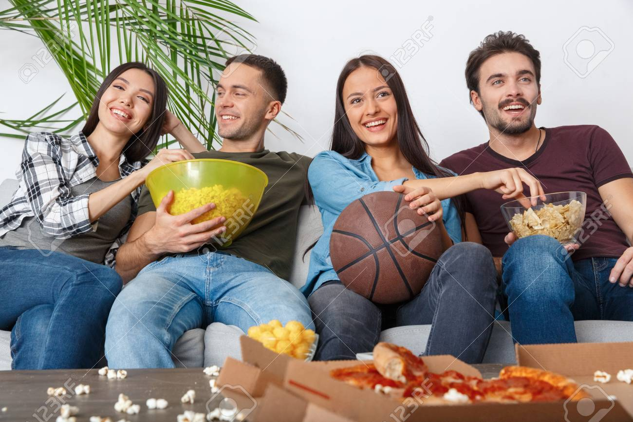Group Of Friends Sport Fans Watching Basketball Game Eating Snacks Stock Photo Picture And Royalty Free Image Image 94717801