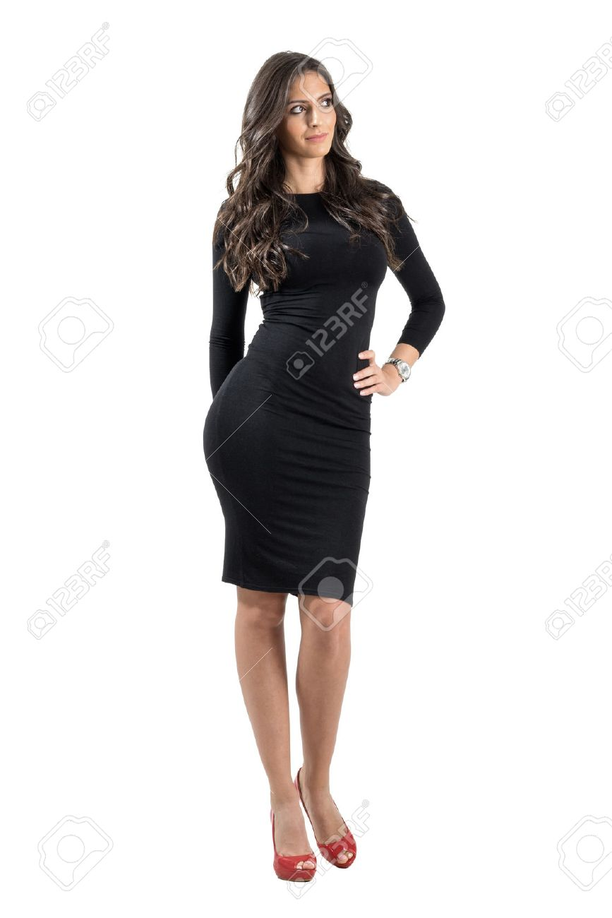 Young Elegant Lady In Black Dress Looking Away With Hand On Her ...