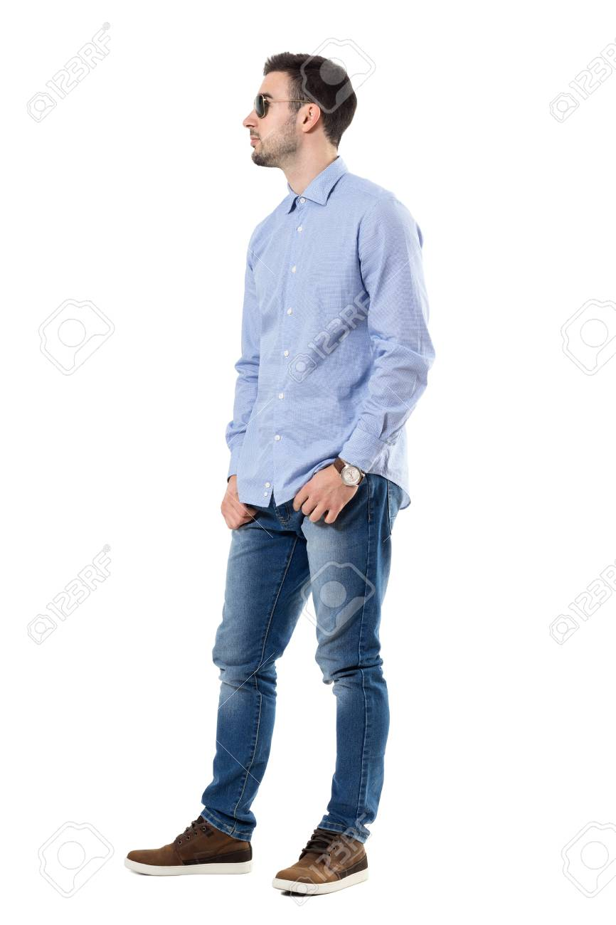 9d38d8a430 Full body length portrait isolated over white background. Cool relaxed smart  casual young man wearing sunglasses with hands in pockets looking away. Full