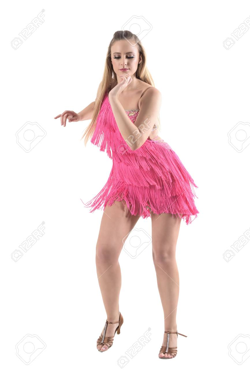 12b2354a6 ... portrait isolated on white studio background. Professional woman dancer  dancing samba dance in pink fringed dress looking down. Full body length