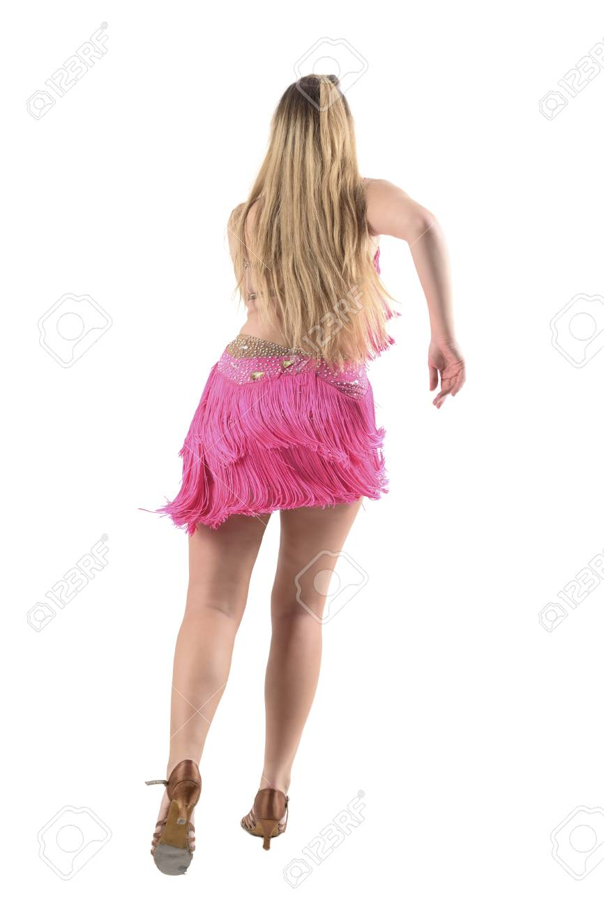 c04ca0ad0 Full body length portrait isolated on white background. Back view of young  latino blonde dancer dancing bachata in pink professional costume. Full body