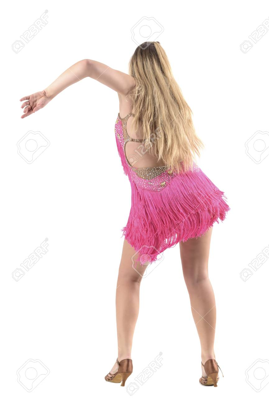 a9291848b Skillful professional latino dancer in pink fringed costume dancing back  view. Full body length portrait