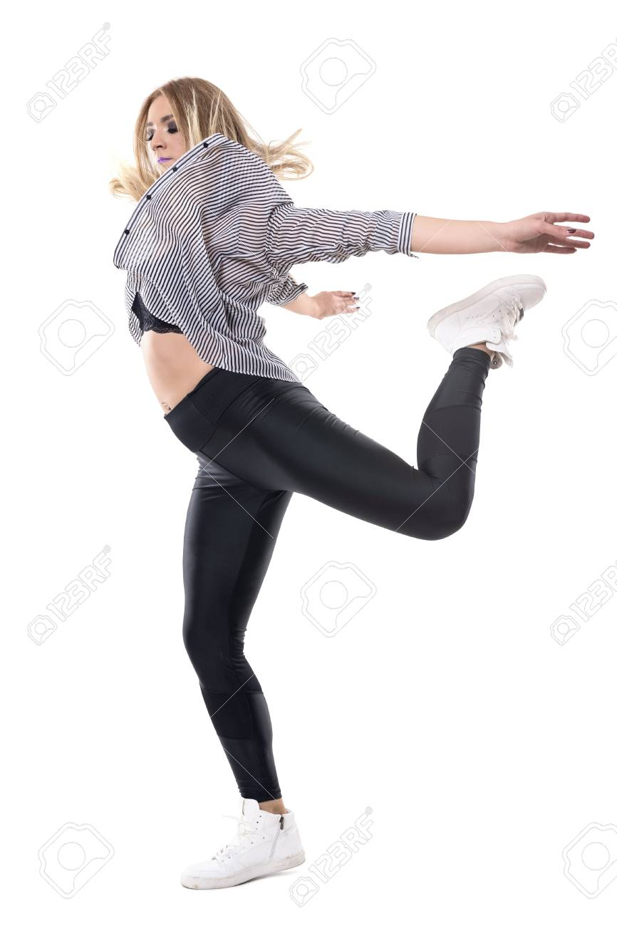 537862852d729 Stock Photo - Young woman jazz dancer in striped shirt and leggings jumping  on one leg with arms behind. Full body length portrait isolated on white ...