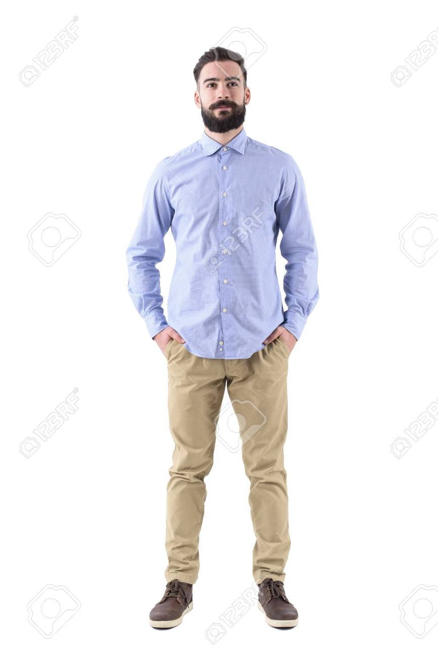 7fe6a1dcebd Front view of young beard smart casual business man with hands in pockets. Full  body