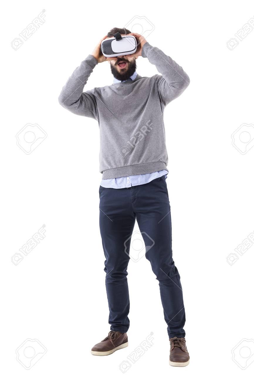 e0b7d9cc8ef Smart casual bearded amazed businessman holding virtual reality headset  glasses. Full body length portrait isolated