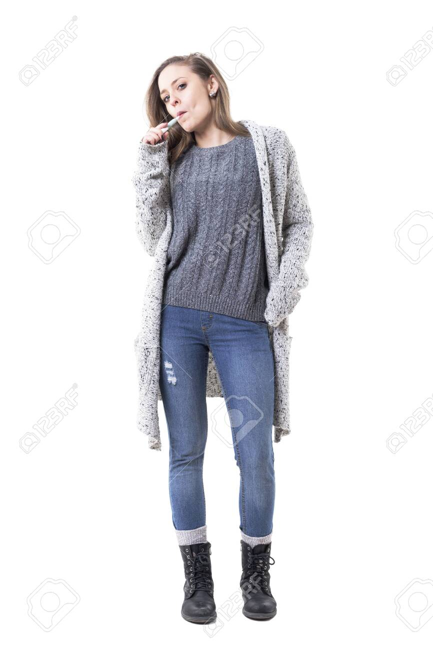 Rebel Young Woman With Defiant Attitude Smoking Electric Cigarette