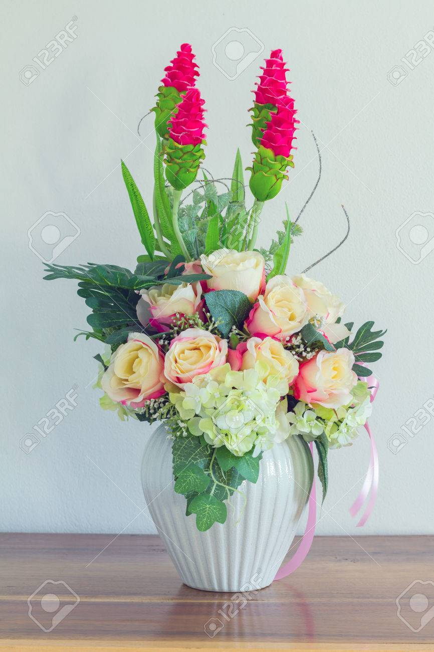 Beautiful fake flowers in whie pot on wood table cool tone stock beautiful fake flowers in whie pot on wood table cool tone stock photo 40270298 izmirmasajfo Choice Image