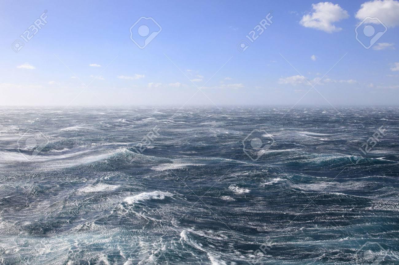 Very stormy seas and Blue Skies Stock Photo - 35249995