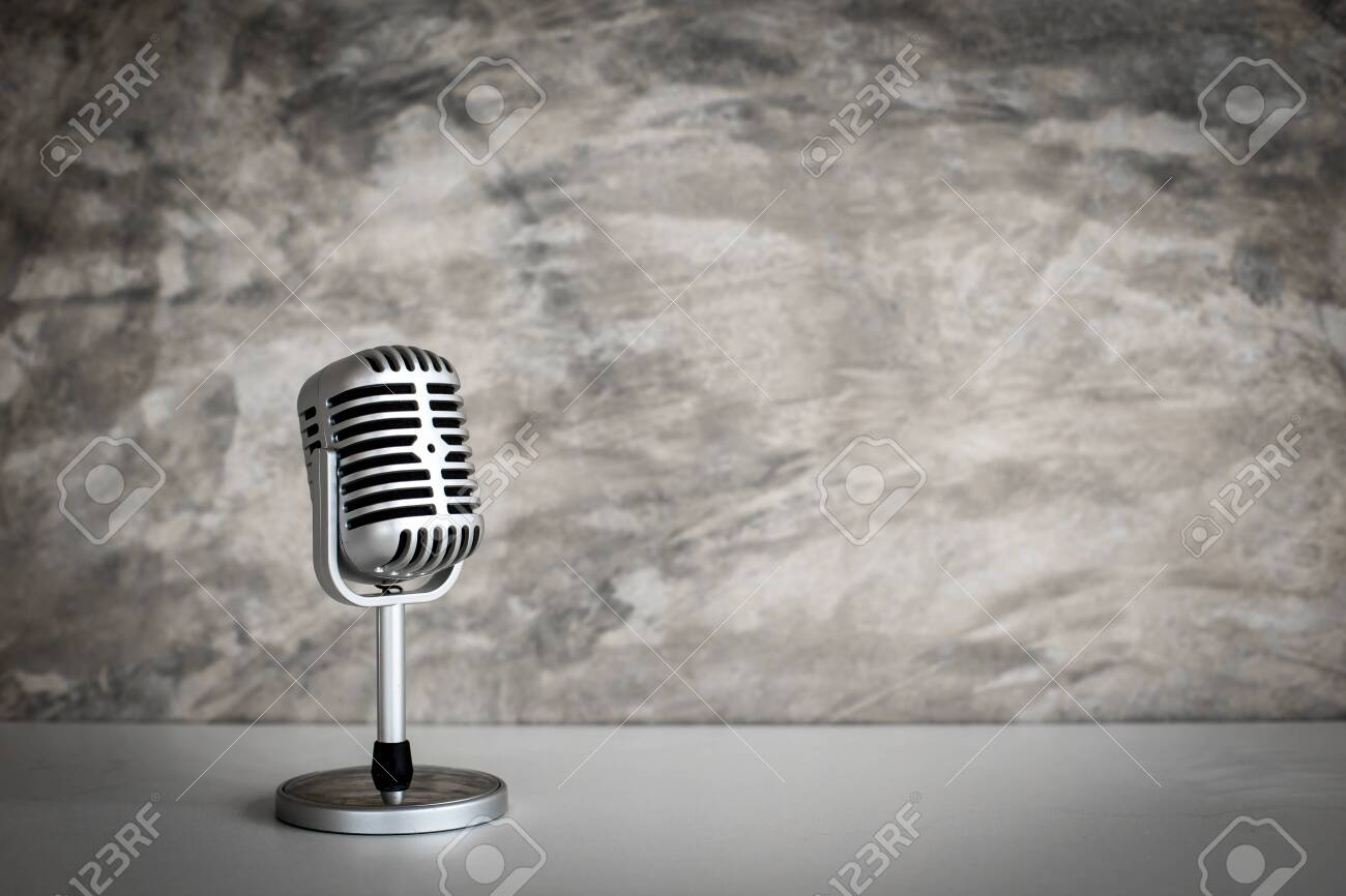 retro microphone on Grunge old background - 129684639