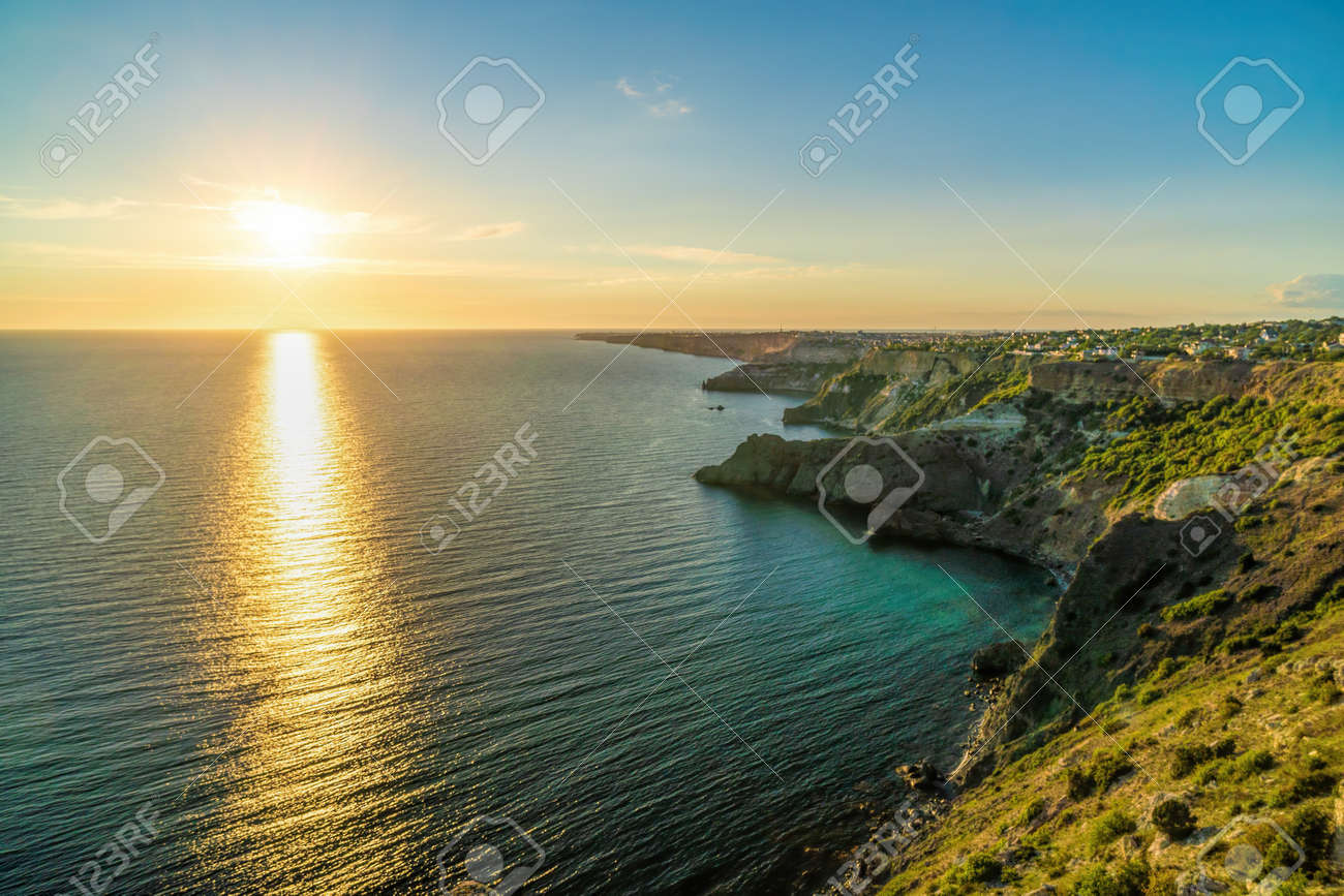 Panoramic seascape, view on rocky seashore, calm azure sea and bright sunset. Copy space. Copy space. Beauty world, nature and outdoors travel concept. - 150030002