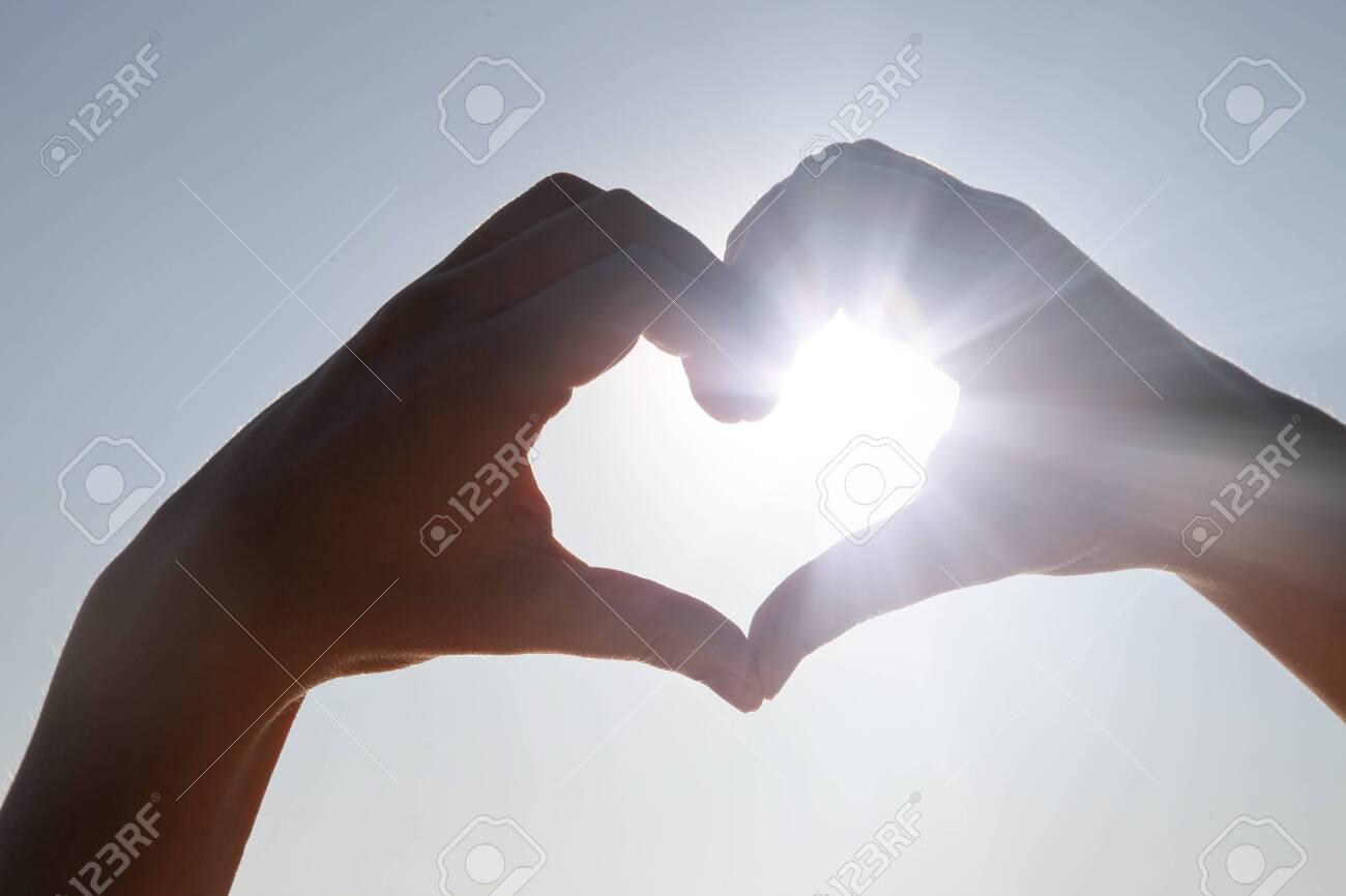 Hands in shape of love heart - 139912872