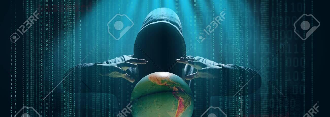 Hacker prints a code on a laptop keyboard to break into a cyberspace - 157905682