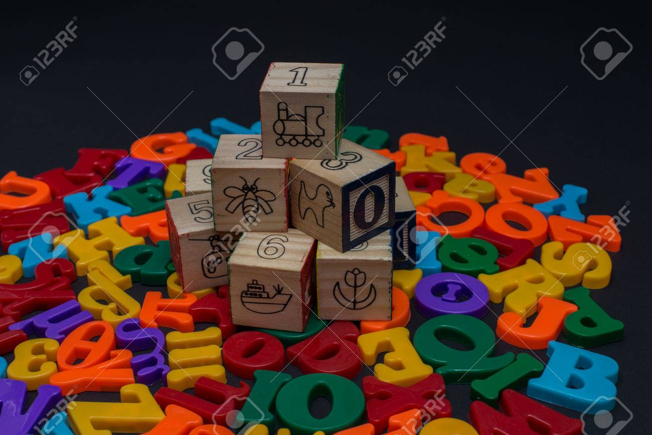 English and Greek Letters of toy alphabet isolated in black background