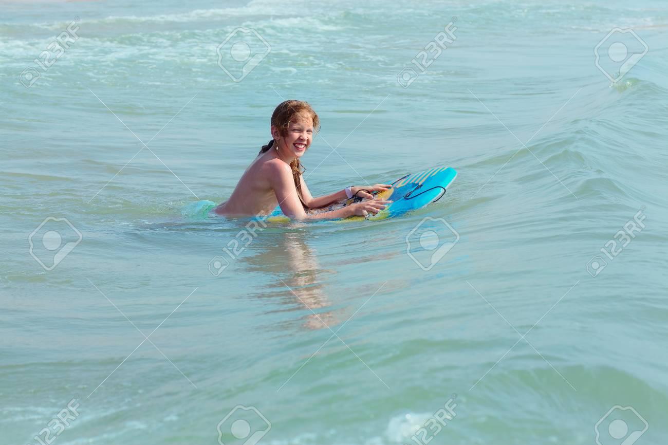Bodysurfing Young Girl Surfing In The Mediterranean Sea Spain