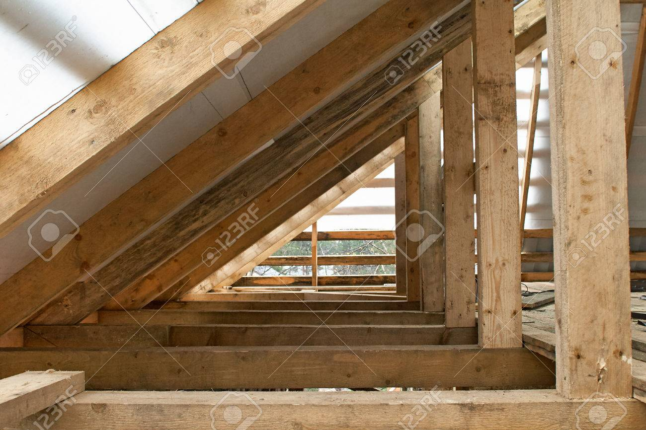 Building Attic Interior. Wooden Roof Frame House Construction ...