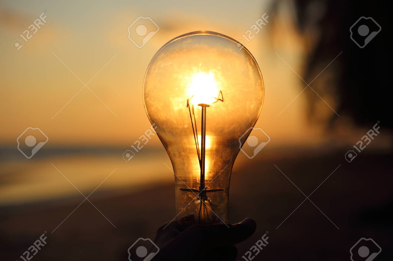 Electric Light Bulb And Sun At Beach Sunset Sky Stock Photo   64406835