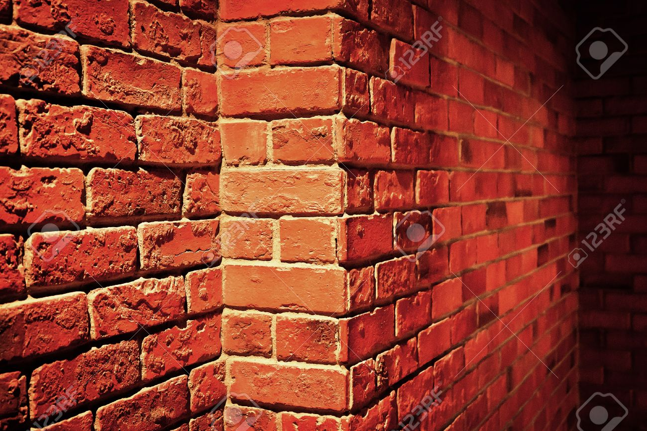 Side View Of Red Brick Wall Texture Grunge Background With Vignetted Stock Photo