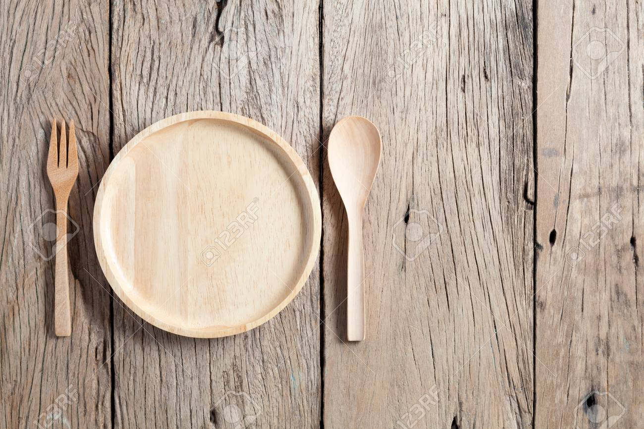 Wooden Spoon And Wooden Plate On Old Wood Table Background Copy Stock Photo Picture And Royalty Free Image Image 81761229
