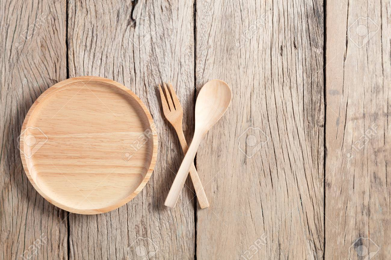 Wooden Spoon And Wooden Plate On Old Wood Table Background Copy Stock Photo Picture And Royalty Free Image Image 87483752